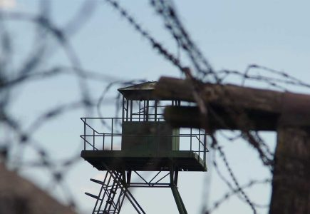 Barbed wire and watchtower
