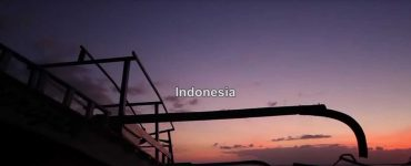 Jetty with sunset with word Indonesia in middle