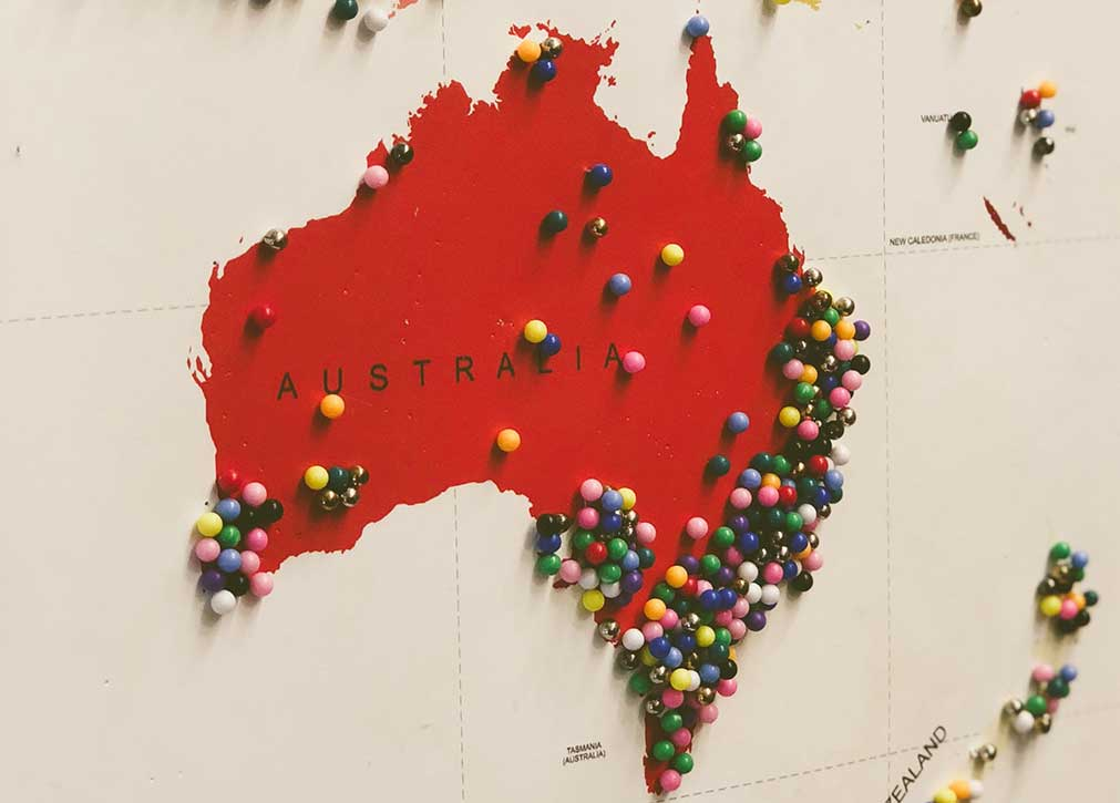 Red map of Australia with coloured pins