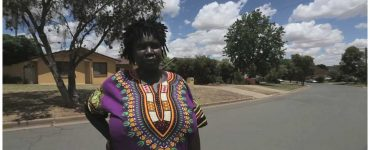 Colourfully dressed woman in suburban street
