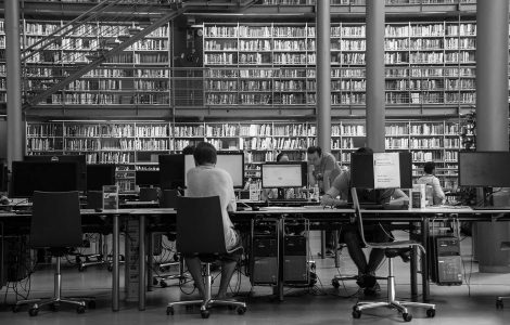 Black-and-white photograph of students in university library