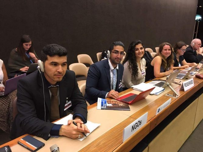 Youth delegates at UN with headphones