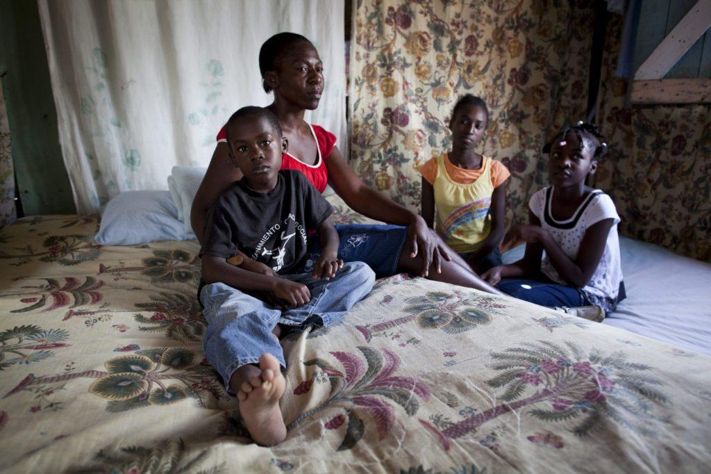 Family sitting on mattress