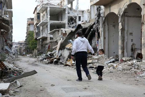 Man holding child's hand amid rubble walking away