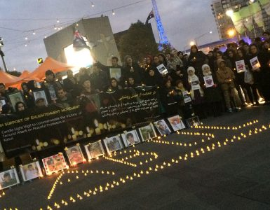 Kabul spelt out in candles at vigil in front of Federation Square, Melbourne