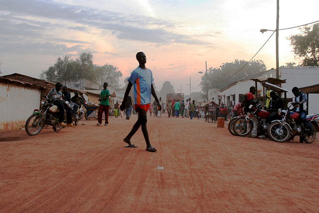 Man walking across ground in Africa