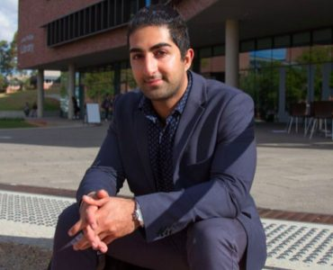 Arash Bordbar sitting on kerby