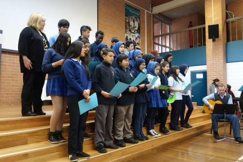 Young children in school uniform in choir