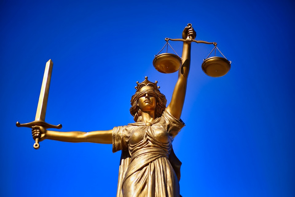 Lady justice holding scales of justice and sword