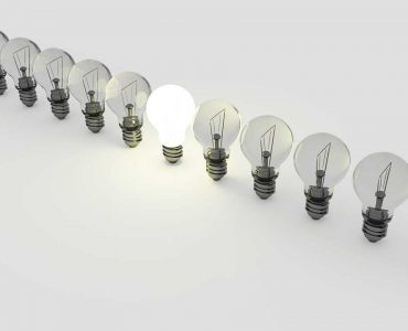Series of lightbulbs with one on
