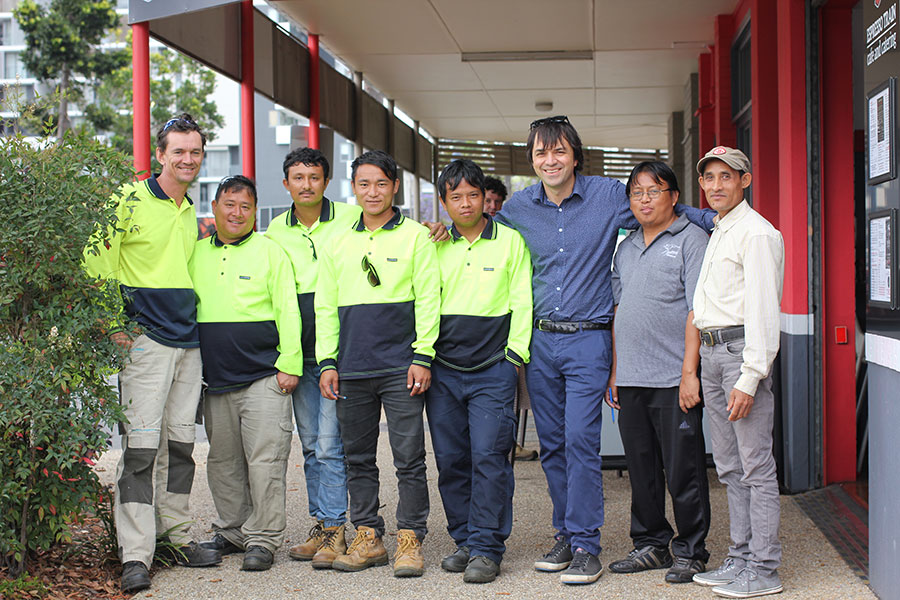 Group of men some in hi-vis vests