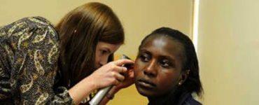 Woman examining patient