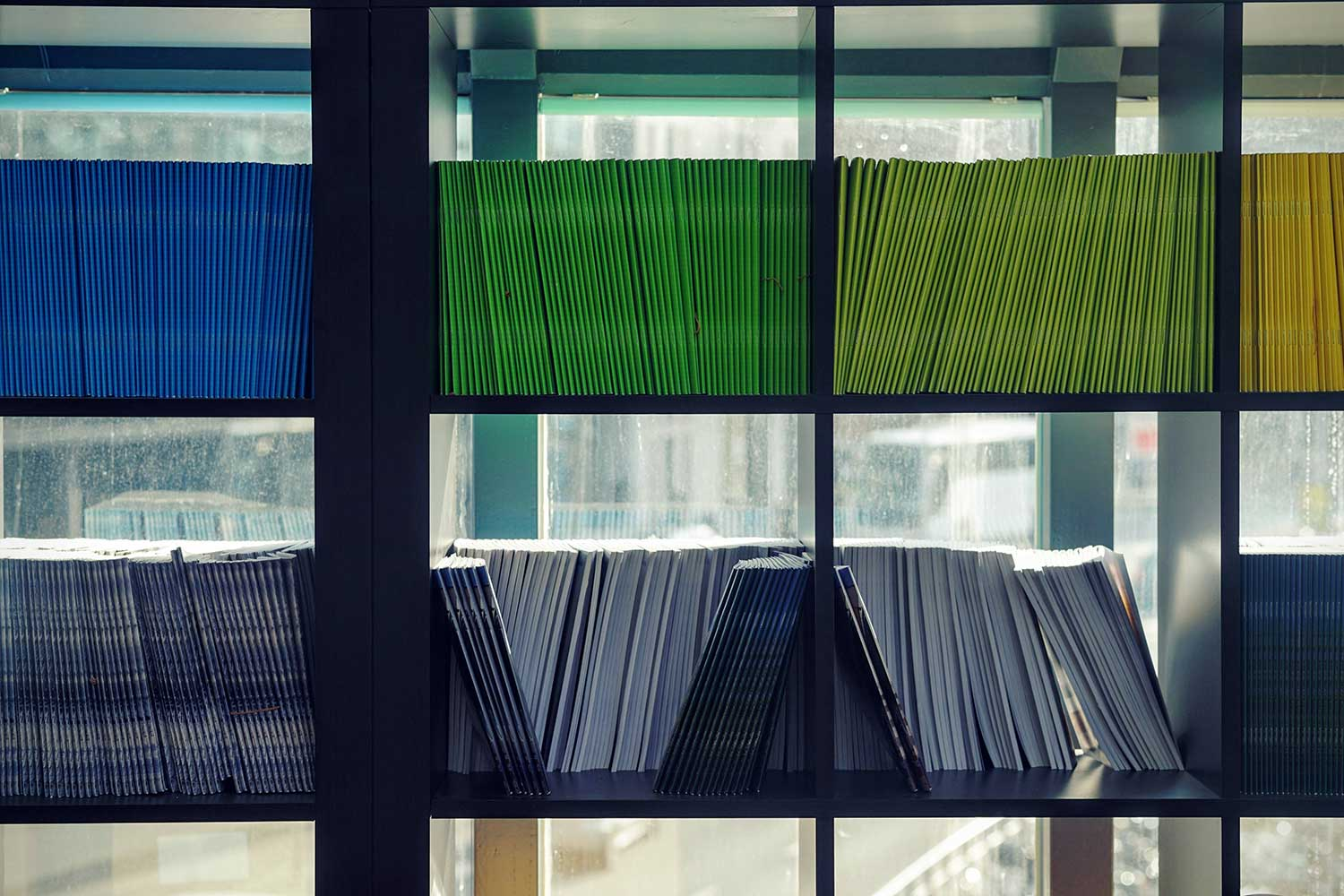 Colourful reports on shelf