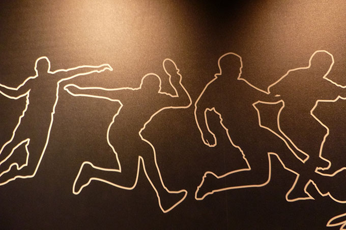 Graphic outline of sports being played