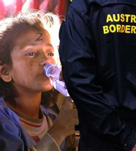 Child with water bottle in front of man with Australian Border Force uniform