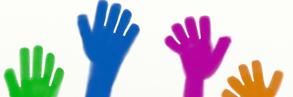 Colourful hands being raised