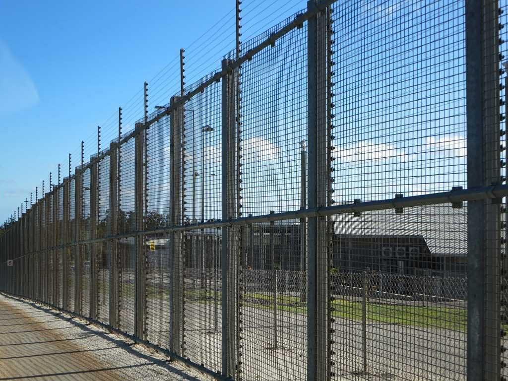 Detention fence against blue sky
