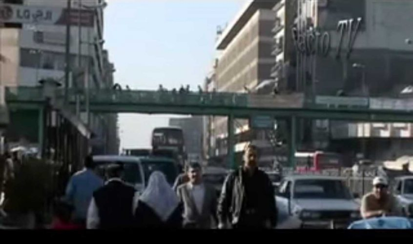 Busy street with bridge overhead