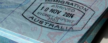 Passport with Australia immigration stamp