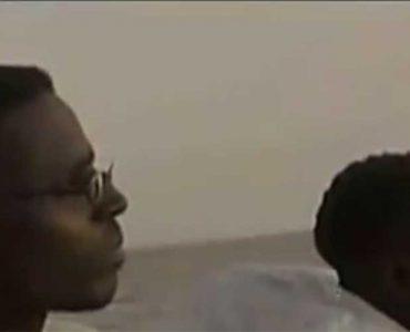 Two men, in profile, on boat