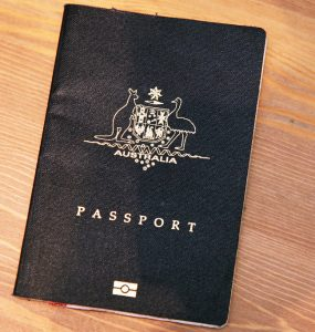 Australian passport on wooden desk