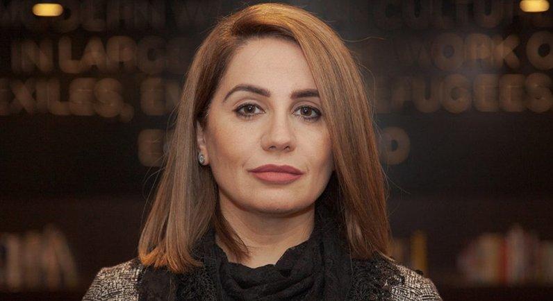 Headshot of woman in black top