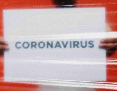 Coronavirus written on white background with red