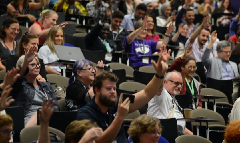 Conference_attendees_hands_up