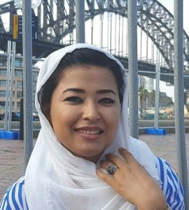 Woman in white headscarf in front of Sydney Harbour Bridge