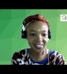 Young woman with headset on and green background